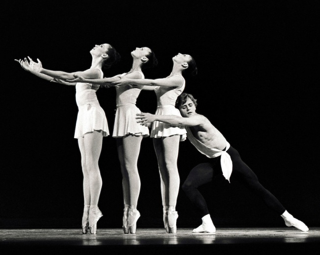 Apollo  Mikhail Baryshnikov with, from left, Heather Watts, Elise Bourne, and Bonnie Bourne Credit Photo ©Paul Kolnik New York City Ballet Choreography by George Balanchine